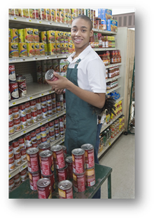 Young man stocking shelves in grocery store